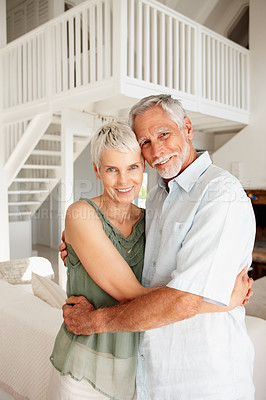 Buy stock photo Charming couple embracing eachother at their home