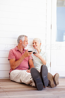 Buy stock photo Portrait of an elderly couple celebrating with a glass of wine