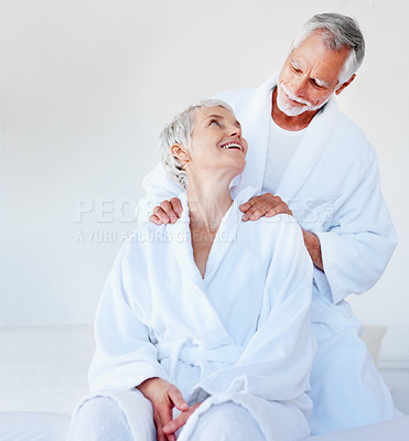 Buy stock photo Portrait of an affectionate man massaging his wife's shoulders