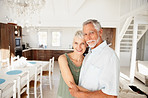 Romantic retired couple having a good time at their home