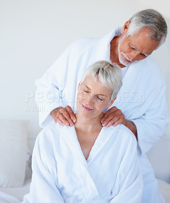 Buy stock photo Mature woman getting a shoulder massage from husband