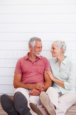 Buy stock photo Mature couple having a good time at home