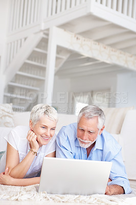 Buy stock photo Portrait of an aged senior couple working on a laptop