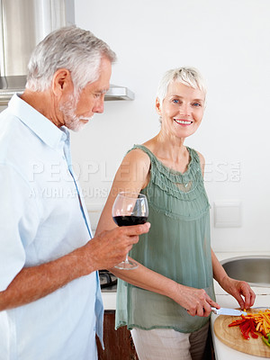 Buy stock photo Old couple in the kitchen preparing salad