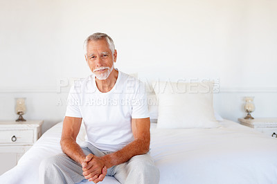 Buy stock photo Portrait of a handsome old man relaxing in the bedroom