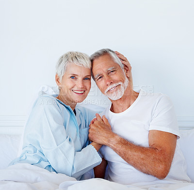 Buy stock photo Senior couple enjoying themselves while in bed
