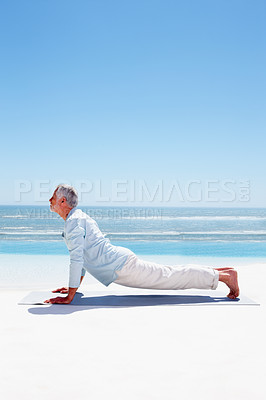 Buy stock photo Attractive fresh senior mature man exercising on the beach
