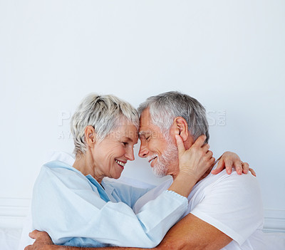 Buy stock photo Profile view of a happy couple putting heads together