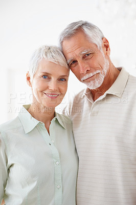 Buy stock photo A cheerful aged old couple smiling together