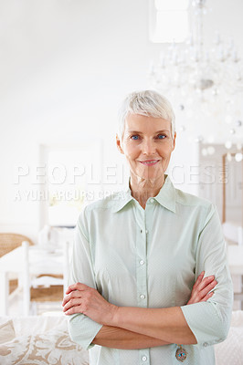 Buy stock photo Happy old woman standing confidently with her hands folded