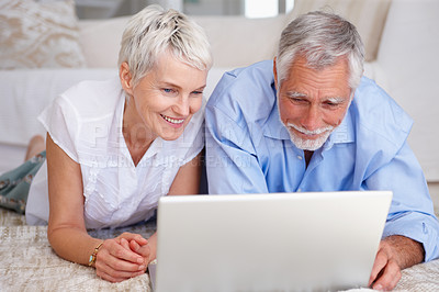 Buy stock photo Portrait of an happy aged couple surfing on a laptop