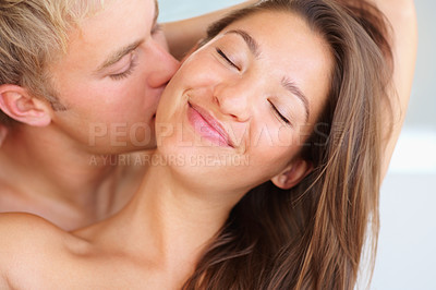 Buy stock photo Passionate young couple enjoying foreplay together