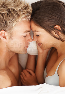 Buy stock photo Overhead view of young intimate couple in bed