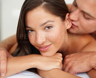 Buy stock photo Closeup of a sexual young couple in bed on their honeymoon