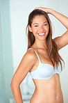 Happy cute woman wearing a bra and posing