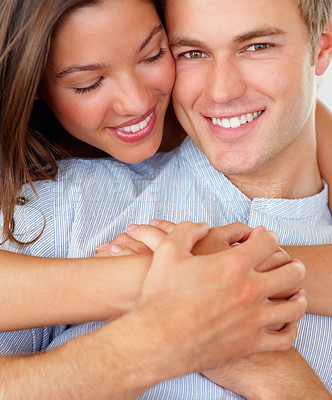 Buy stock photo Closeup portrait of a pretty woman hugging her boyfriend from behind