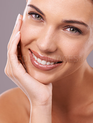 Buy stock photo Beauty shot of a beautiful young woman with perfect skin against a gray background