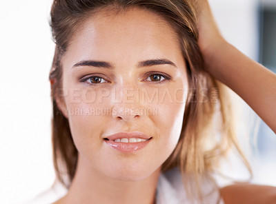 Buy stock photo Cropped beauty shot of an attractive young woman standing in her home