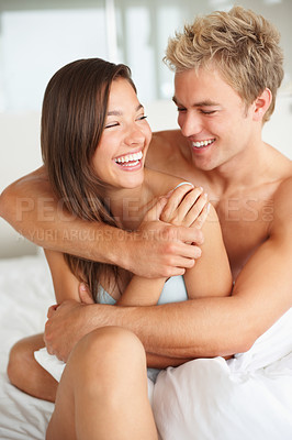 Buy stock photo Happy romantic couple enjoying themselves on bed in the morning