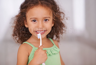Buy stock photo Portrait of an adorable little girl holding a toothbrush