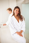 Cute woman wearing a bath robe with her husband at the back
