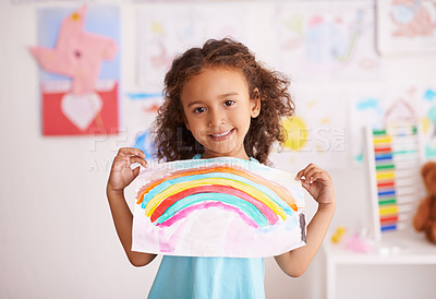 Buy stock photo Shot of a little girl holding up a picture she painted of a rainbow