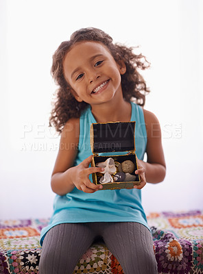 Buy stock photo Shot of an adorable little girl holding a box