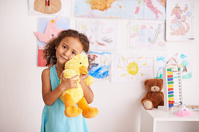 Buy stock photo Portrait of an adorable little girl holding her teddybear