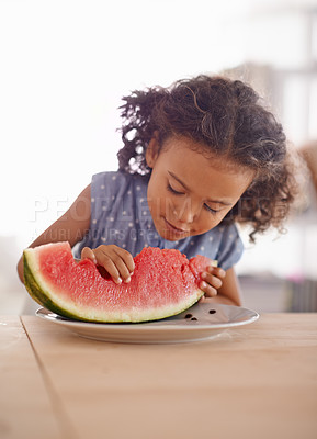 Buy stock photo Shot of a cute little girl eating watermelon at a table