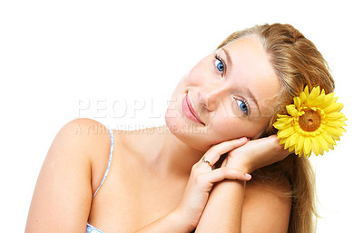 Buy stock photo Studio shot of a young woman holding a flower isolated on white