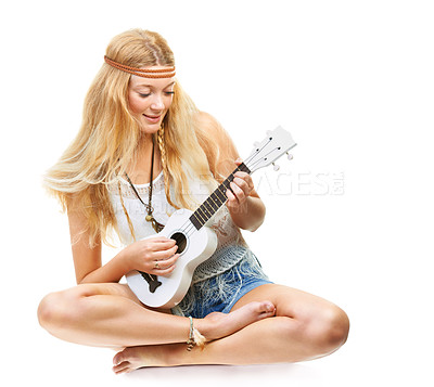 Buy stock photo Studio shot of an attractive flower child playing a guitar isolated on white