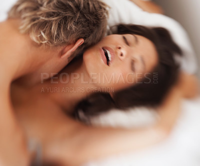 Buy stock photo Young couple making love passionately