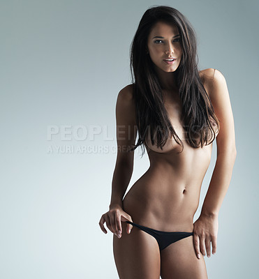 Buy stock photo Studio shot of a beautiful semi-clad woman against a gray background