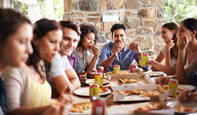 Buy stock photo Cropped shot of a group of friends enjoying pizza together