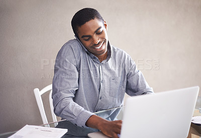 Buy stock photo Shot of a handsome young man working on his laptop at home