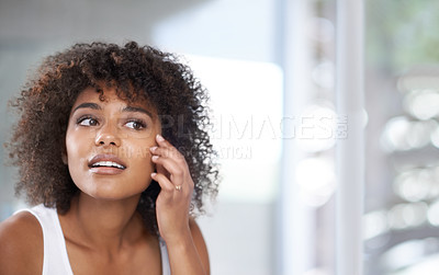 Buy stock photo Shot of an attractive young woman in her bathroom at home