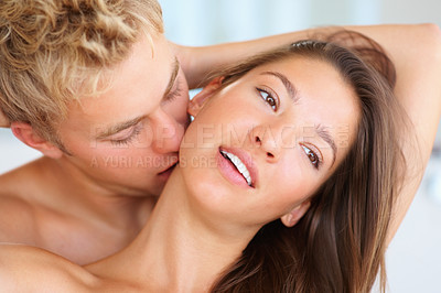 Buy stock photo Closeup portrait of a young couple indulging in the act of foreplay