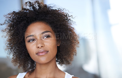 Buy stock photo Shot of an attractive young woman looking thoughtful in her home