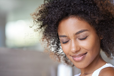 Buy stock photo Cropped shot of an attractive young woman with her eyes closed