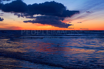 Buy stock photo Shot of a beautiful sunset over the beach