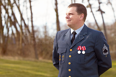 Buy stock photo Shot of a high ranking military officer standing at ease in the outdoors