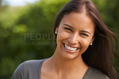Buy stock photo A beautiful young woman smiling outdoors