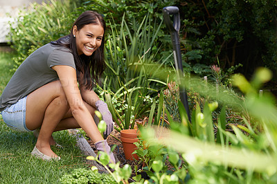Buy stock photo Full length shot of a pretty brunette working in her garden