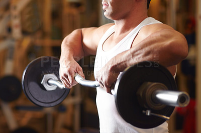 Buy stock photo Handsome sportive man at the gym doing exercises