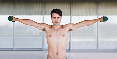 Buy stock photo A portrait of a focused young man lifting dumbbells
