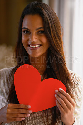 Buy stock photo Shot of an attractive ethnic woman holding her heart shaped Valentine's day card