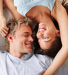 Happy young couple in love lying on the floor