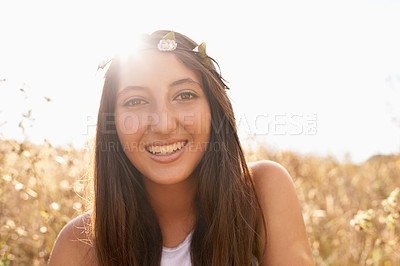 Buy stock photo Portrait of an attractive teenage girl in a field with the sun behind her