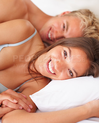 Buy stock photo Young attractive happy amorous couple together on the bed