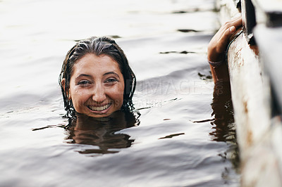 Buy stock photo Portrait of a happy teenage girl swimming in a lake